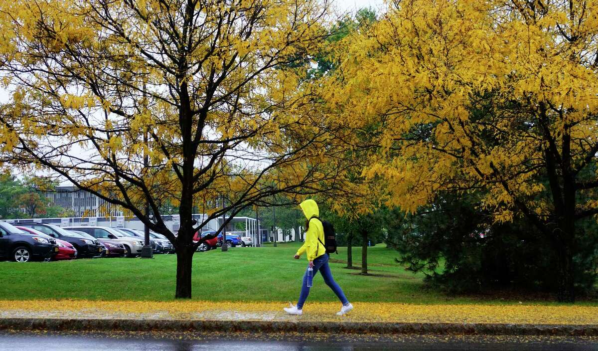 A student makes her way through the campus in the rain at the University at Albany on Thursday, Oct. 11, 2018, in Albany, N.Y. (Paul Buckowski/Times Union)