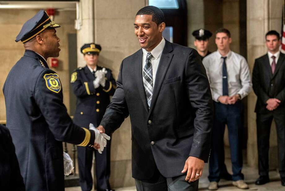 Albany Police Chief Eric Hawkins, left, greets recruit Corey Johnson Jr. at the swearing-in of nineteen new Albany Police officers by Albany Mayor Kathy Sheehan Thursday Oct.11, 2018 in Albany, N.Y. (Skip Dickstein/Times Union) Photo: SKIP DICKSTEIN, Albany Times Union / 20045092A