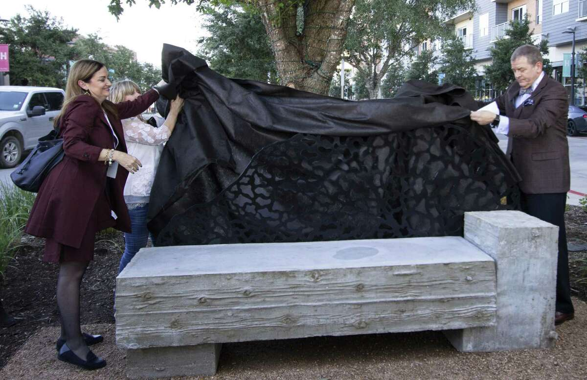 The Howard Hughes Corp. is hosting an art crawl and craft beer tasting from 2 to 5 p.m. Nov. 3 at Hughes Landing along Lake Woodlands. Deborah and Jeff Cobum remove a sheet from the Quercus bench, one of the benches in the crawl, during an unveiling Wednesday, Oct. 10, 2018 at Hughes Landing in The Woodlands.