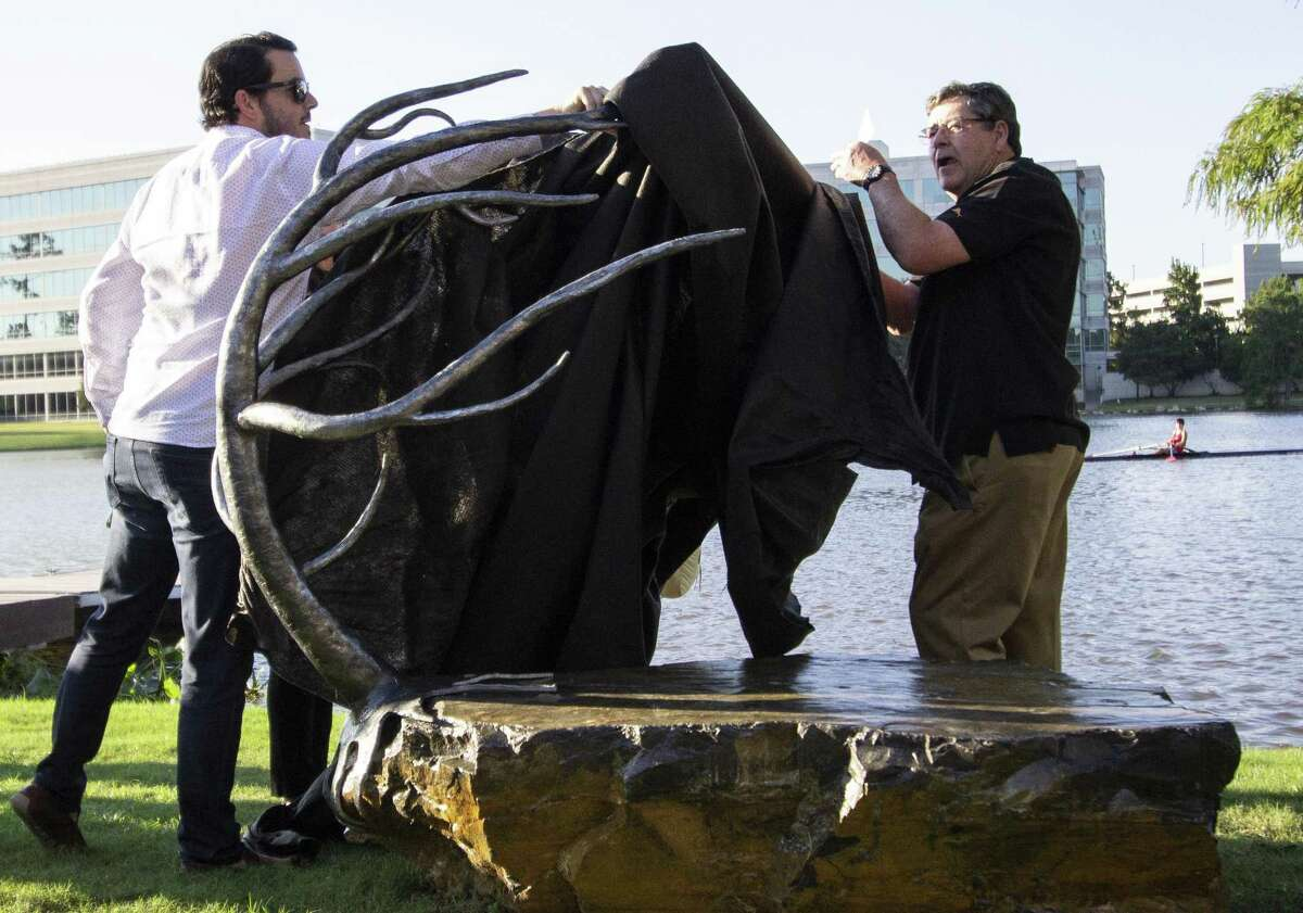 The Howard Hughes Corp. is hosting an art crawl and craft beer tasting from 2 to 5 p.m. Nov. 3 at Hughes Landing along Lake Woodlands. The Dorman family removes the sheet from the Resolute bench, one of the benches in the crawl, during an unveiling Wednesday, Oct. 10, 2018 at Hughes Landing in The Woodlands. Resolute was underwritten by the family in honor of Matt Dorman who died after a fight with cancer.