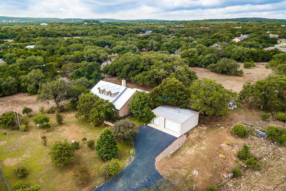 Sponsored by John Hill  VIEW DETAILS for 565 Falling Water in Spring Branch OPEN SATURDAY FROM 1-4 AND SUN FROM 2-5 Updated and ready to move in 4 BR & 3 Bath w/media/bonus room on 10 acres of secluded perfection just minutes away to your private access on the Guadalupe River. Comal ISD. Immaculately maintained home w/ updated Gourmet Chef's kitchen, private master suite w/ luxurious bath, hydrotherapy tub, giant shower, 3 eating areas, massive oaks gardens, horse barn, 4-car garage & abundant wildlife. 3 living areas, screened in porch, pool, hickory hardwood floors, newly remodeled bonus room within minutes of the best retail, restaurants & Texas's Bests winery's John Hill, Realtor 210-716-2210 Photo: Photo Provided By John Hill