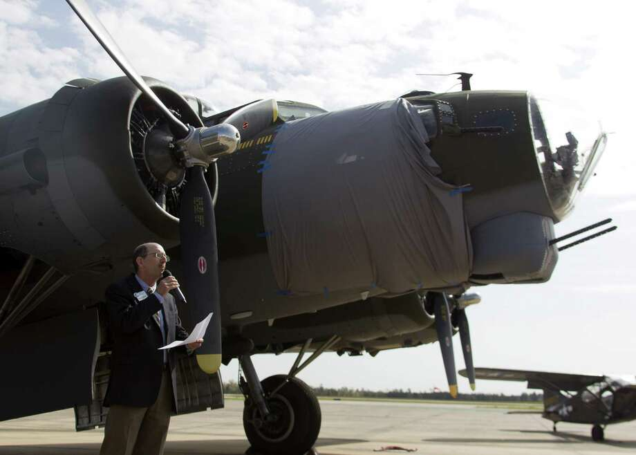Brian Bondy, president of the Conroe/Lake Conroe Chamber of Commerce, speaks during a welcoming ceremony for a B-17 Flying Fortress, known as 'Texas Raiders,' at the General Aviation Services on the north side of Conroe-North Houston Regional Airport Wednesday, March 8, 2017, in Conroe. The heavy-bomber, maintained and operated by the Commemorative Air Force Gulf Coast Wing, initially flew out of David Wayne Hooks Memorial Airport, but will now call the Montgomery County airport home. Photo: Jason Fochtman, Staff Photographer / Houston Chronicle / © 2017 Houston Chronicle