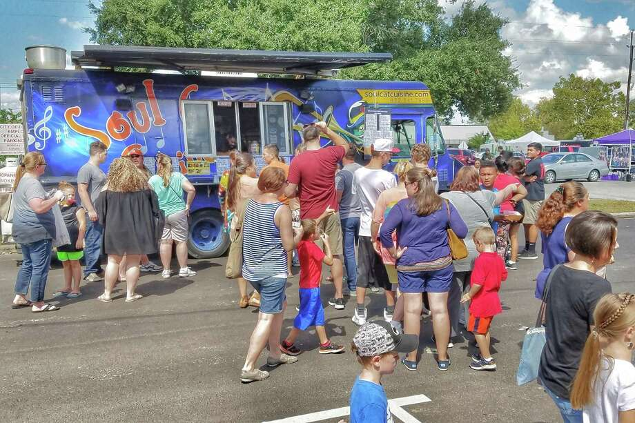 Guests at a previous Freight Train Food Truck Festival enjoy food from Soul Cat Cuisine, which will also be attending the third annual festival this year on Oct. 20 in Tomball. Photo: Courtesy Of The City Of Tomball / Courtesy Of The City Of Tomball