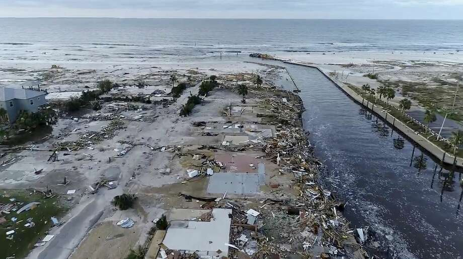 In this image made from video and provided by SevereStudios.com, damage from Hurricane Michael is seen in Mexico Beach, Fla. on Thursday, Oct. 11, 2018. Search-and-rescue teams fanned out across the Florida Panhandle to reach trapped people in Michael's wake Thursday as daylight yielded scenes of rows upon rows of houses smashed to pieces by the third-most powerful hurricane on record to hit the continental U.S. (SevereStudios.com via AP) Photo: AP