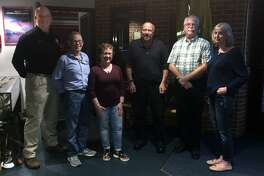 At an event that took place at the Westport Fire Department headquarters on Sept. 26, outgoing Community Emergency Response Team President Ernie Heidelberg, second on left, and his wife Zulema Heidelberg third on left, congratulate the newest members of Westport CERTs Executive Board: President Mike Vincelli, third on right; Vice President David Kinyon, second on right; and Treasurer Shari Brennan, first on right. Joining them was Bob Kenny, Region 1 coordinator for the Connecticut Division of Emergency Management and Homeland Security, first on left.