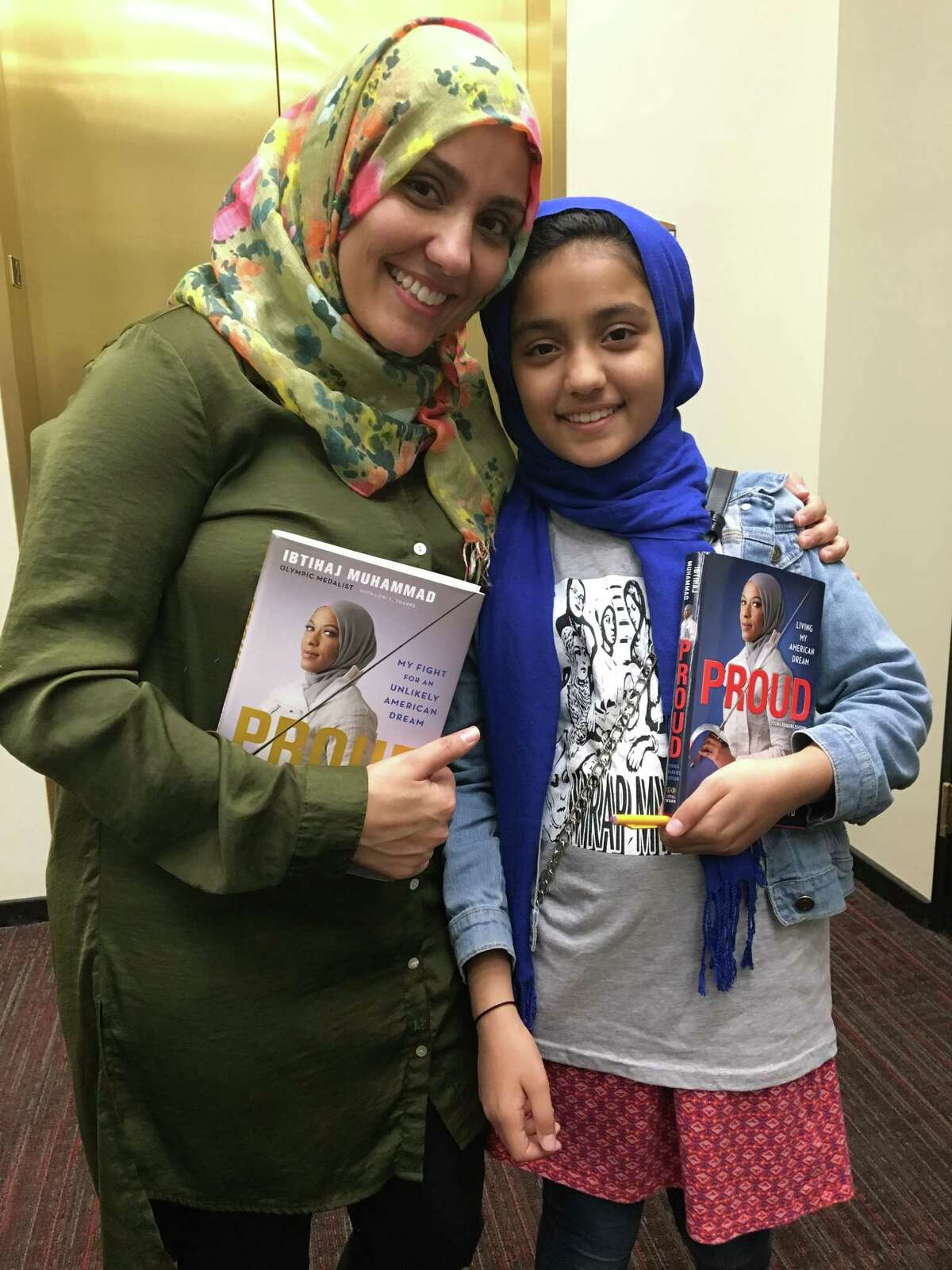 Nine-year-old Zainab Sharifa-Mukhtar and her mother Fatima Mukhtar from Clifton Park met two Muslim-American female icons at the University at Albany Performing Arts Center in Albany, N.Y. on Wednesday, Oct. 10, 2018.