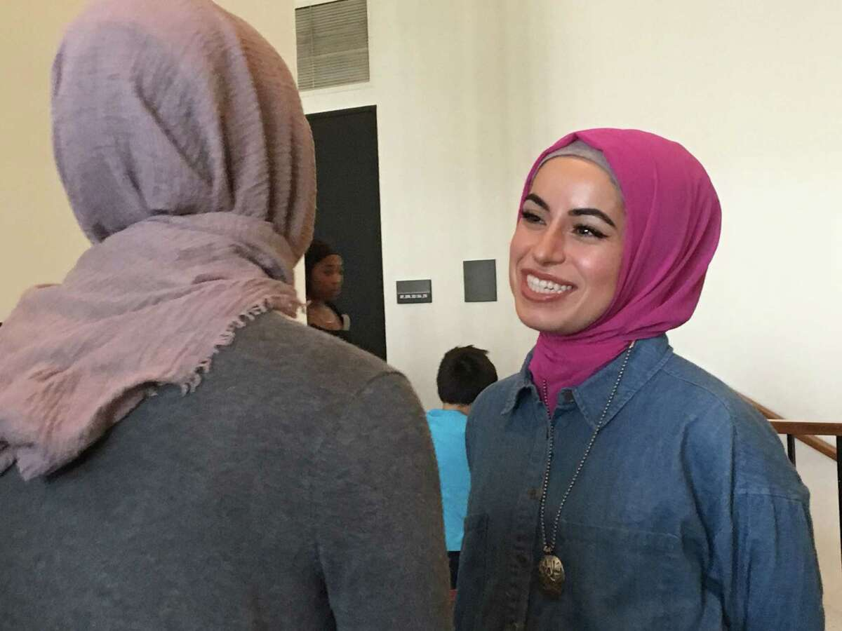Rapper Mona Haydar meets with a fan at the University at Albany Performing Arts Center on Wednesday, Oct. 10, 2018.
