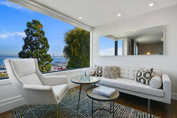 The sitting area in the owner�s suite at 1400-1404 Montgomery St. in Telegraph Hill looks out at San Francisco Bay and the Bay Bridge.