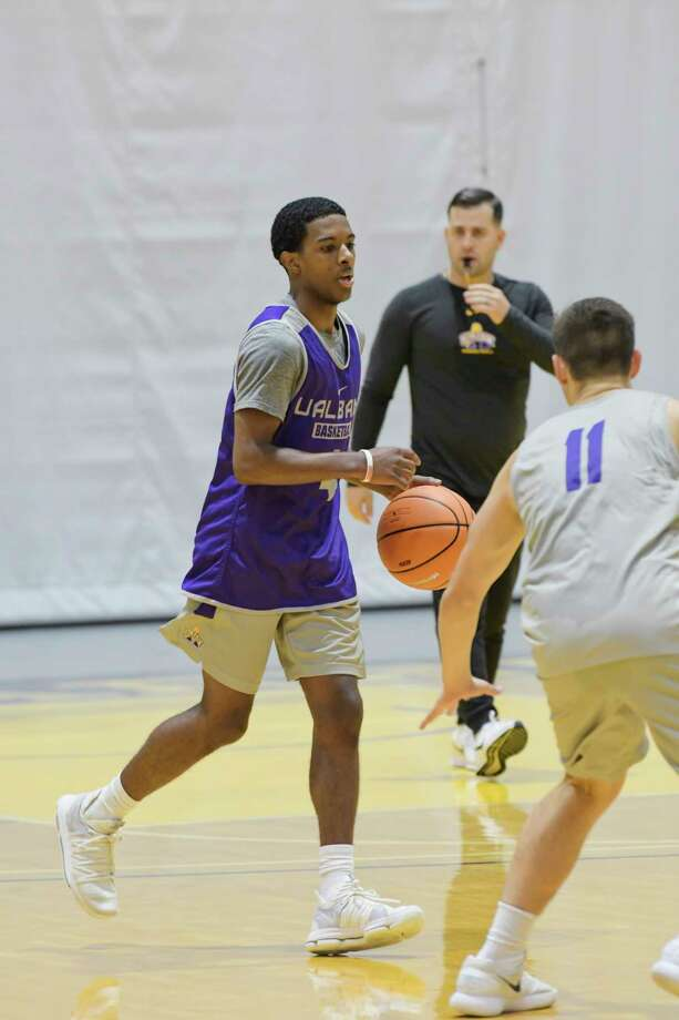 University at Albany men's basketball player, Reece Brooks, left, runs through drills with teammates during practice on Thursday, Oct. 11, 2018, in Albany, N.Y.   (Paul Buckowski/Times Union) Photo: Paul Buckowski, Albany Times Union / (Paul Buckowski/Times Union)