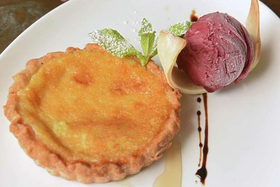 Buttermilk pie - buttermilk custard with raspberry sorbet at Kiernan's Craft Tavern Wednesday, Oct. 3, 2018 in Latham, N.Y. (Lori Van Buren/Times Union)