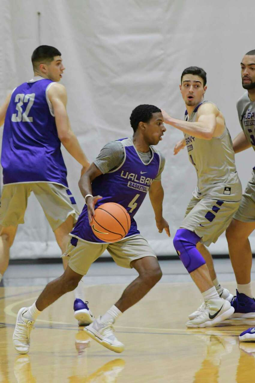University at Albany men's basketball player, Reece Brooks, left, runs through drills with teammates during practice on Thursday, Oct. 11, 2018, in Albany, N.Y. (Paul Buckowski/Times Union)
