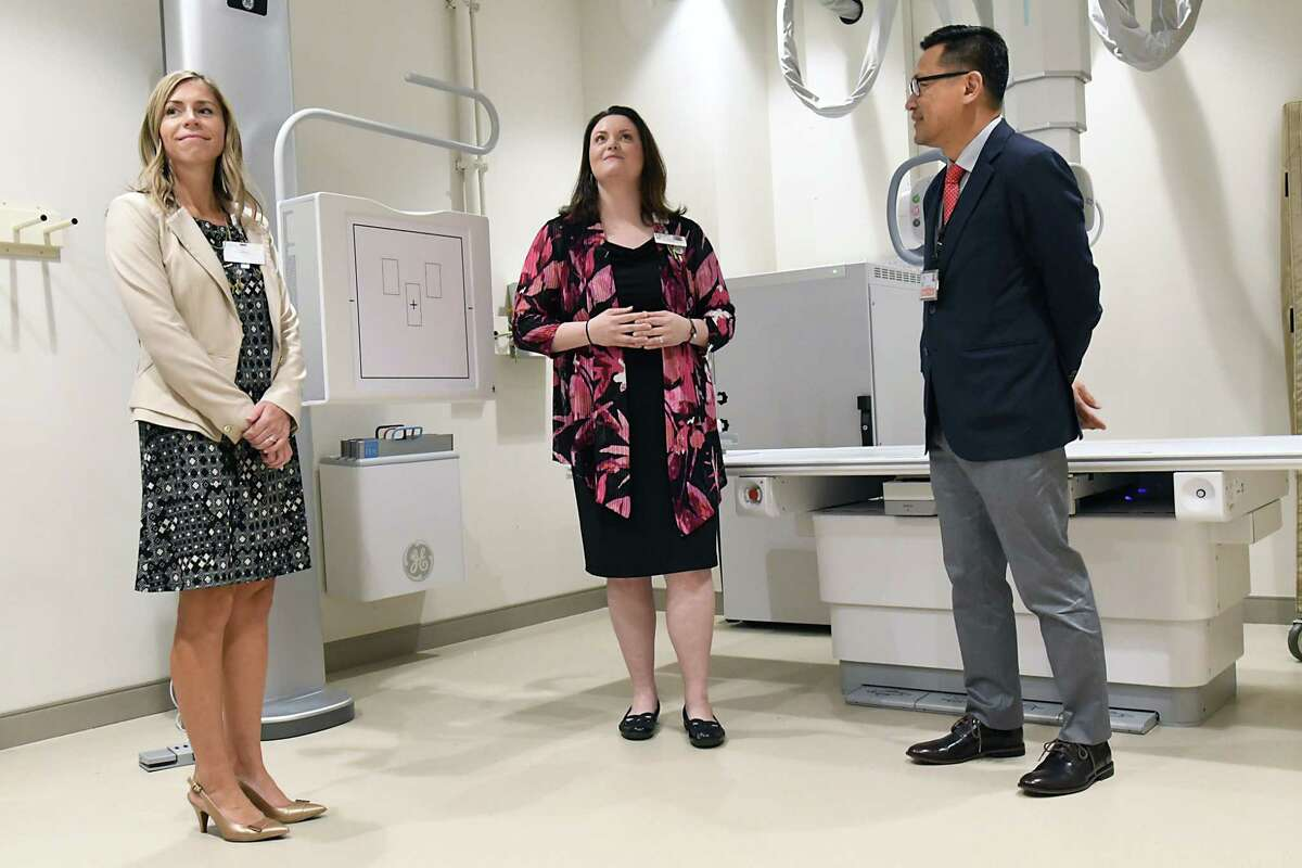 From left, Cori Olsen, senior director of business development and strategic planning, Ashley DePalma, senior project manager and process improvement manager, and Dr. J. Antonio Reyes, a Mohawk Harbor physician who also serves as Ellis's Medical Director of Primary Care, stand in the x-ray imaging room as they lead a tour of Ellis Medicine's new 10,000-square-foot urgent and primary care practice at Mohawk Harbor on Thursday, Oct. 11, 2018 in Schenectady, N.Y. The new facility is set to open on Monday. (Lori Van Buren/Times Union)