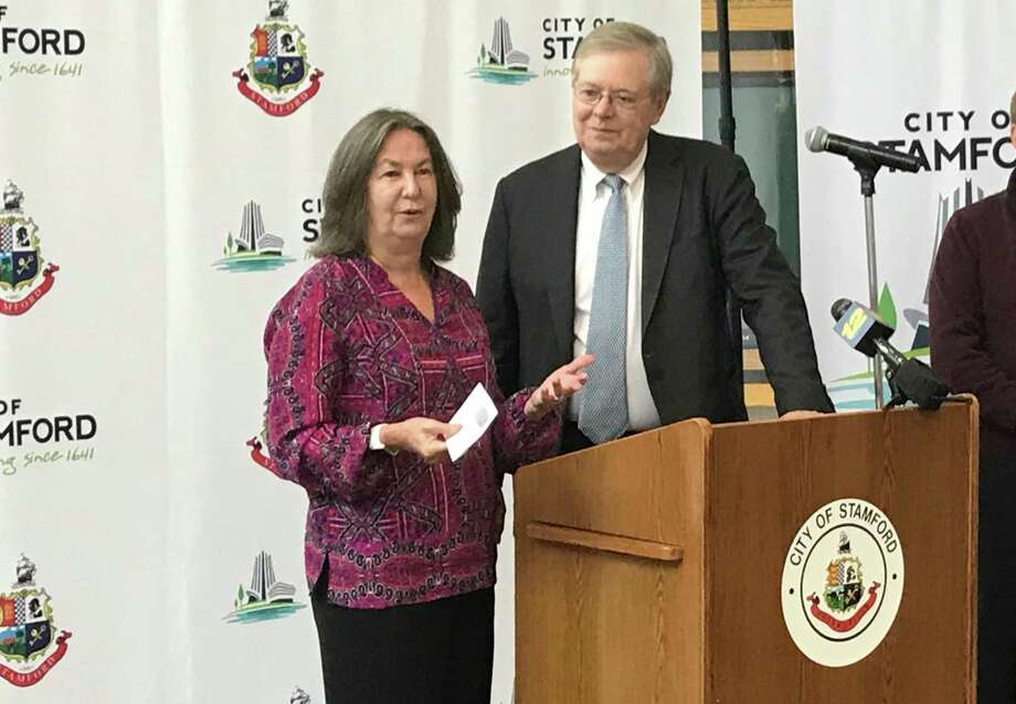 Marti Etter, executive director of the Ballet School of Stamford, thanks Mayor David Martin for the city's support during a presentation of the city's Community Arts Partnership Program grants on Thursday, Oct. 11, 2018. Photo: Barry Lytton / Hearst Connecticut Media / Stamford Advocate