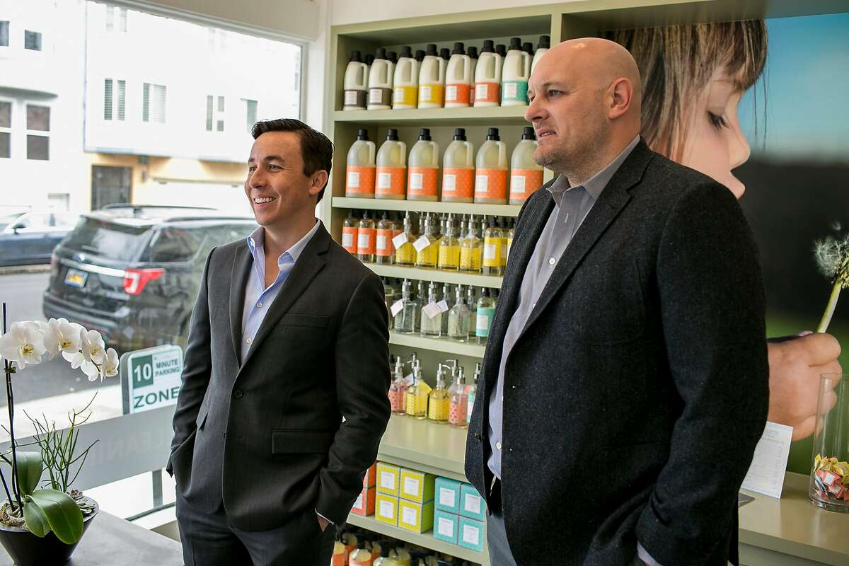 From left, Dan Miller, CEO of Mulberrys Garment Care, and Tad Jenkins, CEO of Laundry Locker, talk at the Mulberrys in the Marina District Thursday, Oct. 11, 2018 in San Francisco, Calif. Mulberrys, a Minnesota dry cleaning company, is buying Laundry Locker making it the largest laundry company in Northern California.