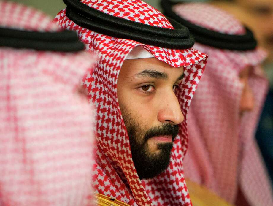 FILE - In this March 22, 2018, file photo, Saudi Crown Prince Mohammed bin Salman meets with U.S. Defense Secretary Jim Mattis at the Pentagon in Washington. In a kingdom once ruled by an-ever aging rotation of elderly monarchs, Saudi Crown Prince Mohammed bin Salman stands out as a youthful face of a youthful nation. But behind a carefully coiffed public-relations operation highlighting images of him smiling in meetings with the world's top business executives and leaders like President Donald Trump, a darker side lurks as well.(AP Photo/Cliff Owen, File) Photo: Cliff Owen / FR170079 AP