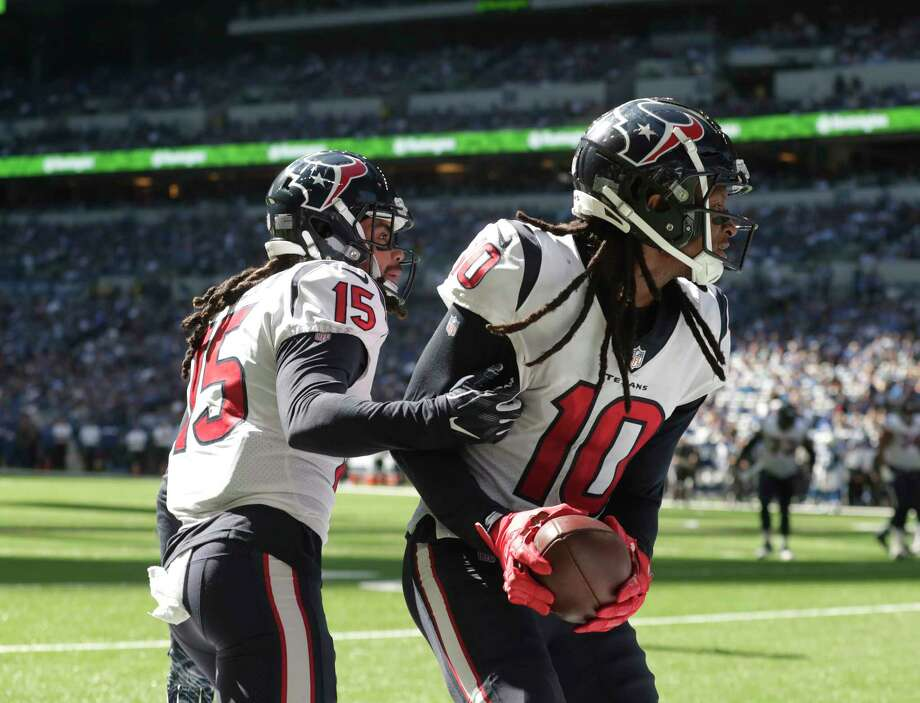 Houston Texans wide receiver DeAndre Hopkins (10) celebrates a touchdown reception with Will Fuller (15) during the first half of an NFL football game against the Indianapolis Colts, Sunday, Sept. 30, 2018, in Indianapolis. (AP Photo/Michael Conroy) Photo: Associated Press / Copyright 2018 The Associated Press. All rights reserved.