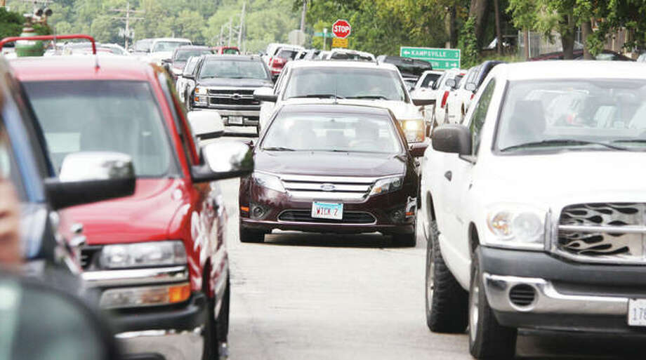 "The Madison County Board will consider a resolution opposing a ""vehicle milage tax"" after the board's Executive Committee approved the resolution Wednesday. The tax has become a political issue in the Illinois governor's race. Photo: Scott Cousins 