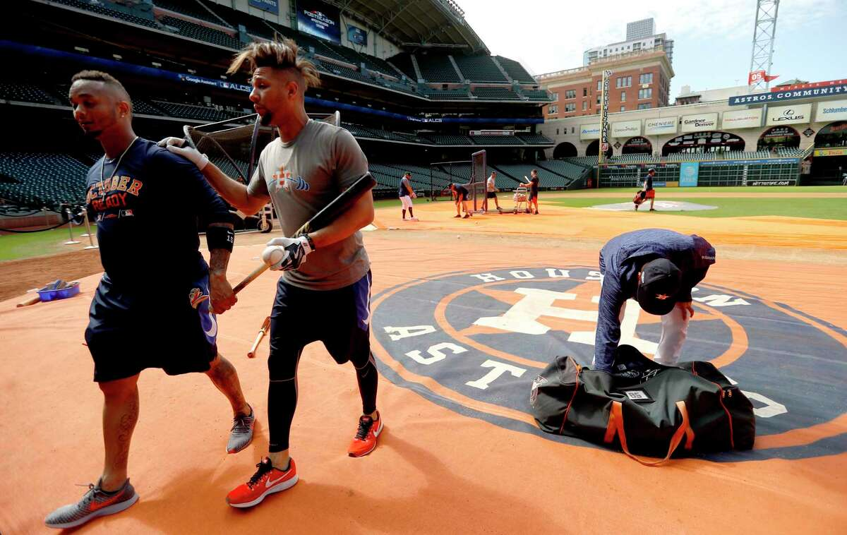Houston Astros catcher Martin Maldonado and Yuli Gurriel walk off the field after their workouts at Minute Maid Park, Thursday, October 11, 2018, in Houston, as the Astros prepare to leave for Boston for the ALCS.