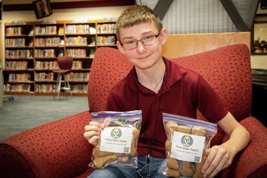 Austin Nelson, an eighth-grader at Seabrook Intermediate School, shows off the dog treats he created as part of a small business plan to raise funds for a band instrument upgrade. Photo: CLEAR CREEK ISD 2017 / WWW.CCISD.NET 281-284-0000