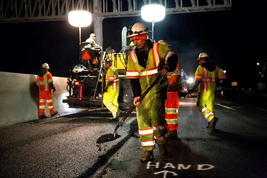 Caltrans contractors pave rubberized hot-mix asphalt on southbound lanes of Interstate 880 in Hayward. State and local transportation officials fear such projects could be frozen if voters pass Proposition 6. Photo: Brittany Hosea-Small / Special To The Chronicle