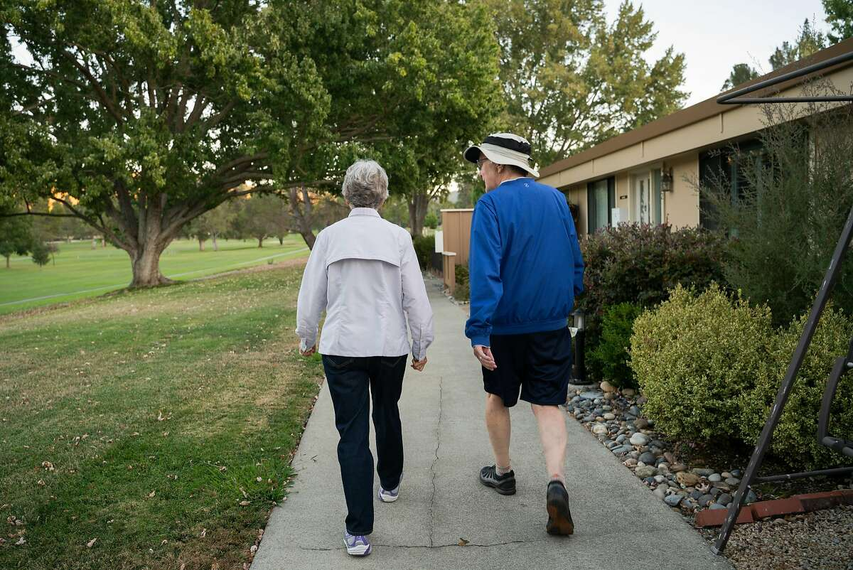 Nancy and Frank Greaney, both 75, take a walk at Rossmoor, a senior community in Walnut Creek, Calif. on Wednesday, October 10, 2018.
