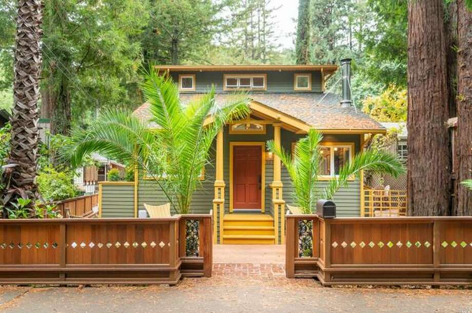 A three-bedroom, two-bathroom Craftsman home at 101 Madrone Ave. in Larkspur, Calif., is listed for $1.795 million and tucked among the redwoods. Photo: Mark Romero