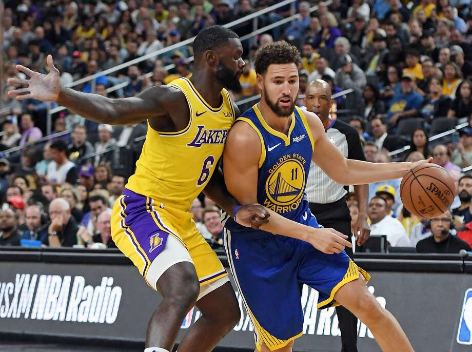d4eb3baa409 Klay Thompson  11 of the Golden State Warriors drives against Lance  Stephenson  6 of