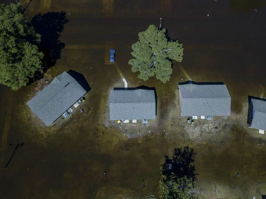 Flooded homes following Hurricane Florence in Lumberton, N.C., Sept. 18. A day after the U.N. issued a call to arms for the world to confront climate change, President Trump, who has mocked the science around it, did not broach the topic, even in vulnerable Florida. Photo: JOHNNY MILANO /NYT / NYTNS