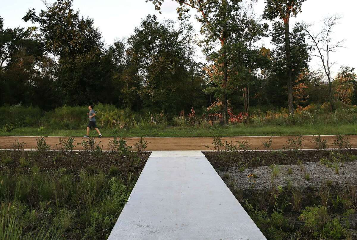 Cement walkways lead from a paid parking lot to Phase I of the Eastern Glades at Memorial Park on Thursday, Oct. 11, 2018 in Houston. The new trail, which is part of the park's ongoing masterplan, opened on Monday.
