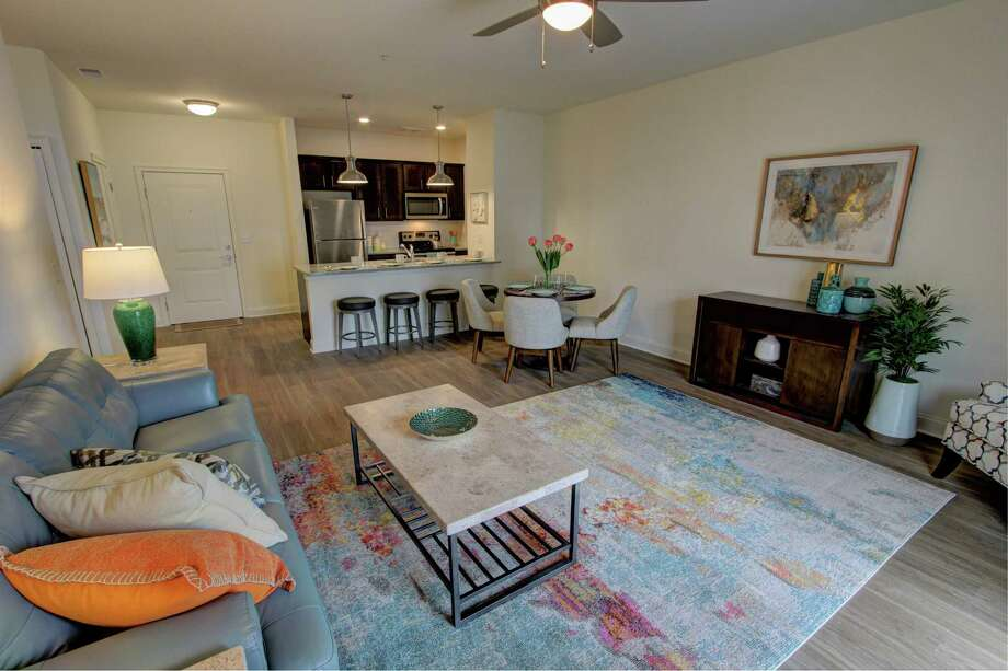 Two-bedroom apartments at Carlton Hollow Apartments in Milton like the one pictured rent for $1,695 and $1,795. The 55+ apartment complex, currently under construction with one building ready for tenants, will have an indoor pickle ball court, a library, an indoor pool and other amenities. (Photo provided) Photo: Photo Provided By Sunrise Property Management