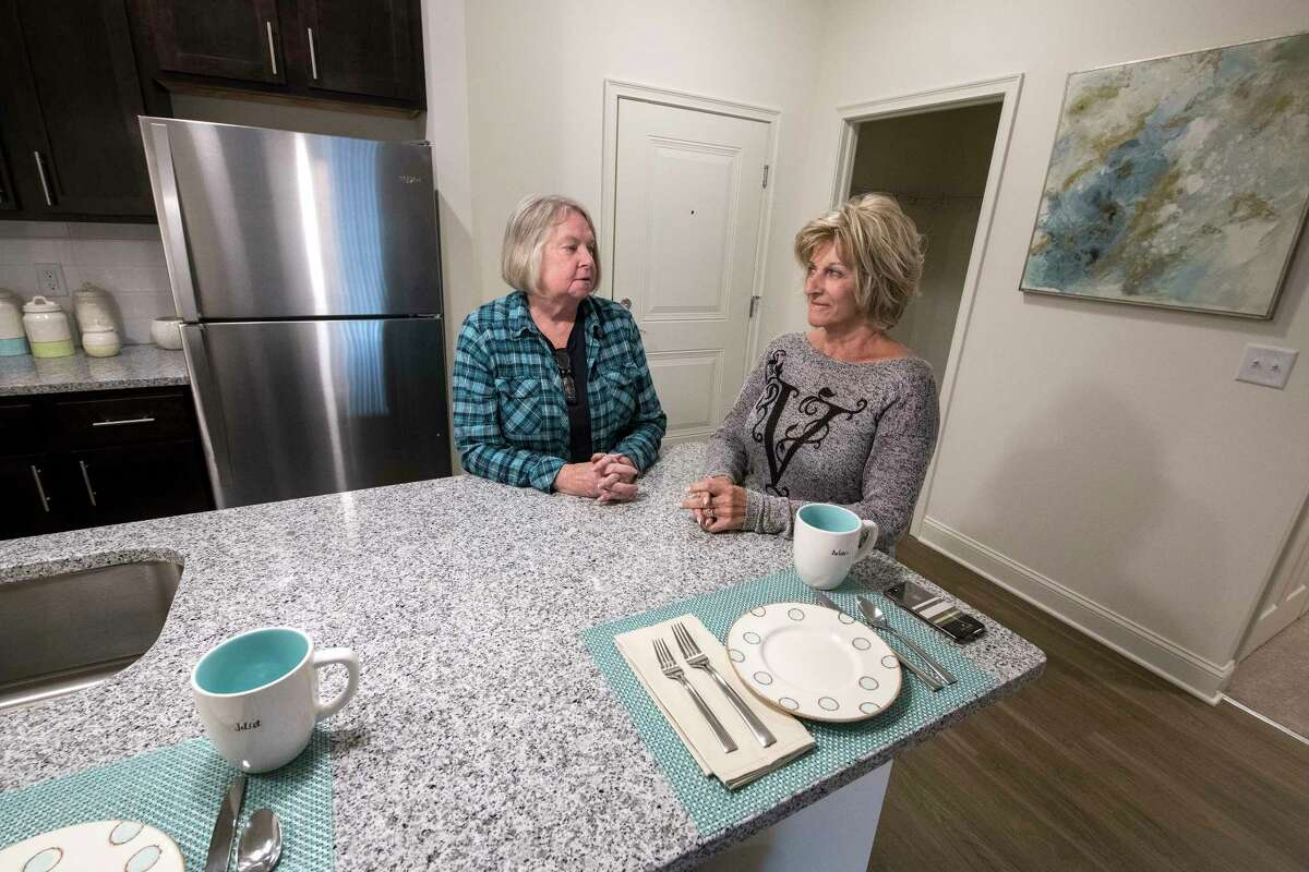 Ann Meehan, left speaks with Roz Baker at the newly constructed Carlton Hollow Apartments Tuesday Oct. 2, 2018 in Ballston Spa, N.Y. (Skip Dickstein/Times Union)