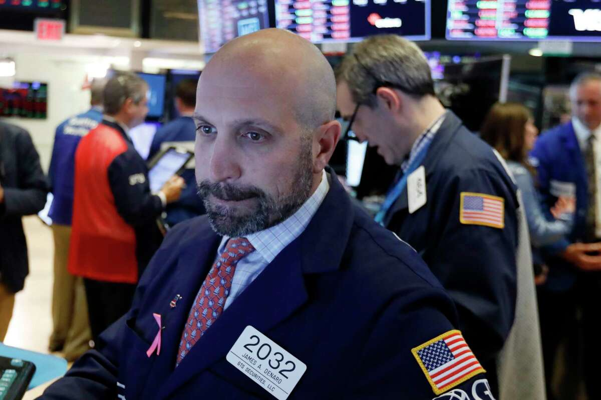 Specialist James Denaro works at his post on the floor of the New York Stock Exchange, Thursday, Oct. 11, 2018. Stocks are slumping for a second straight day as the market endures its most volatile stretch since February. (AP Photo/Richard Drew)