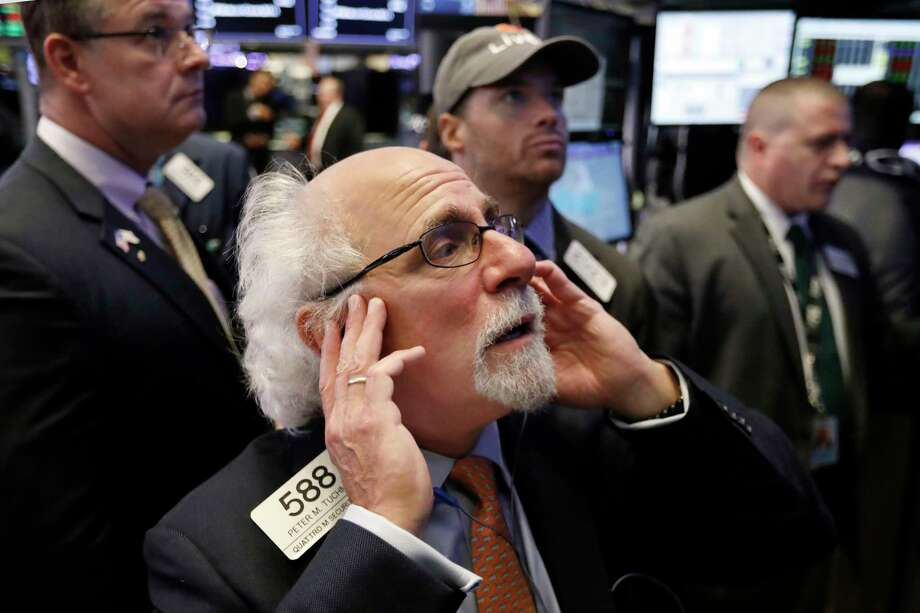 Trader Peter Tuchman works on the floor of the New York Stock Exchange, Thursday, Oct. 11, 2018. The market's recent decline was set off by a sharp drop in bond prices and a corresponding increase in yields last week and early this week. (AP Photo/Richard Drew) Photo: Richard Drew / Copyright 2018 The Associated Press. All rights reserved
