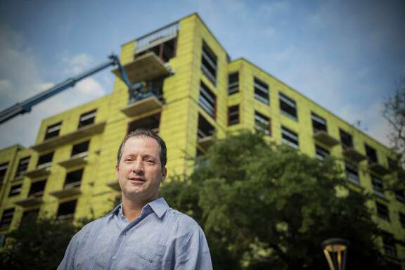 Developer David Adelman stands in front of his newest apartment bulding, The '68 at Hemisfair.