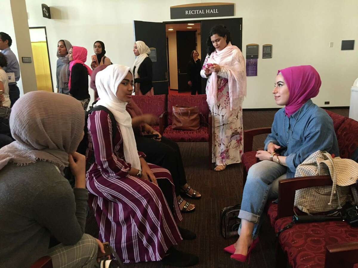 Rapper Mona Haydar, rights, meets fan at the University at Albany Performing Arts Center on Wednesday Oct. 10, 2018.