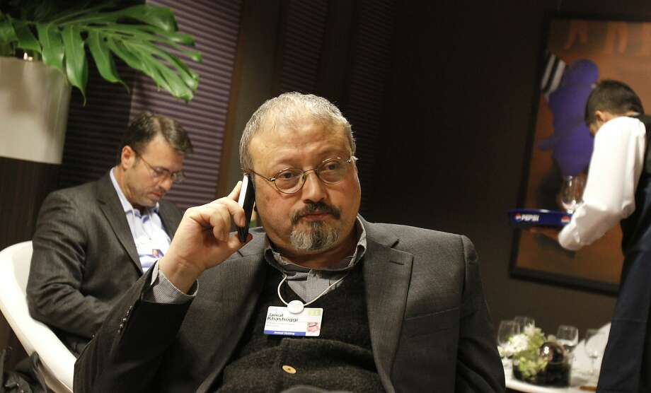 FILE - In this Jan. 29, 2011, file photo, Saudi Arabian journalist Jamal Khashoggi speaks on his cellphone at the World Economic Forum in Davos, Switzerland. The Washington Post said Wednesday, Oct. 3, 2018, it was concerned for the safety of Khashoggi, a columnist for the newspaper, after he apparently went missing after going to the Saudi Consulate in Istanbul. (AP Photo/Virginia Mayo, File) Photo: Virginia Mayo / Associated Press 2011