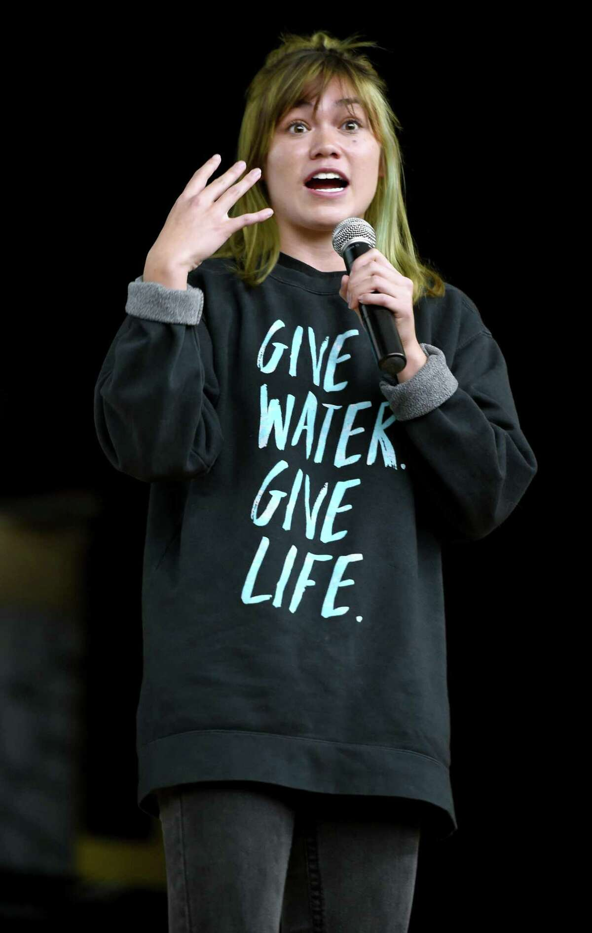 Darcy Kerrigan of the Thirst Project speaks at Jonathan Law High School in Milford Monday at the invitation of the Key Club about the lack of clean drinking water in Swaziland and much of the world.