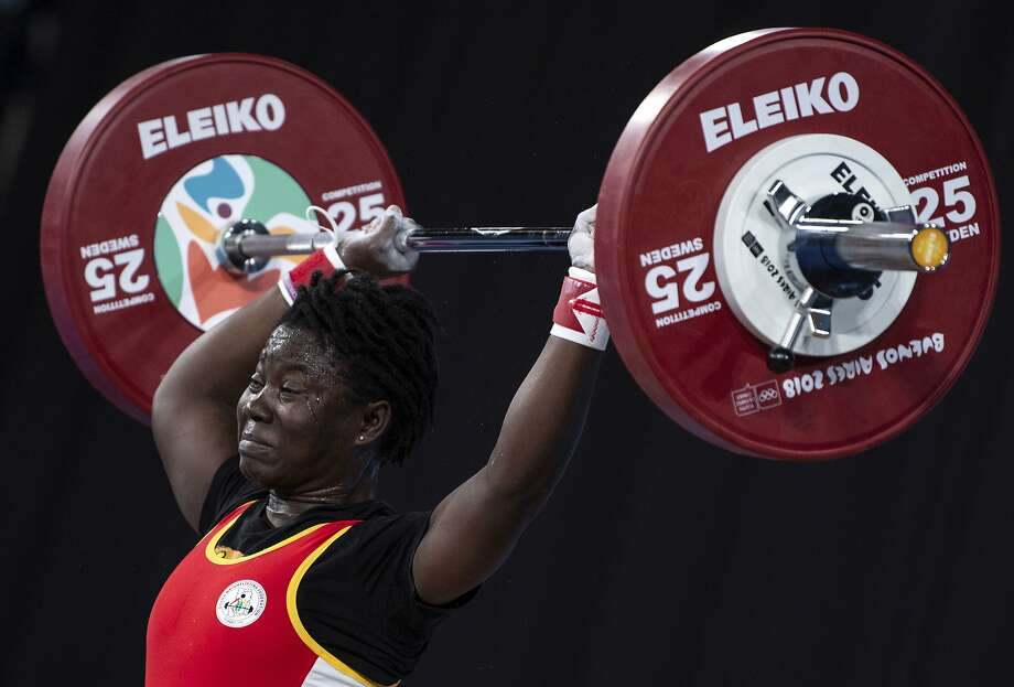 In this photo provided by the OIS/IOC, Ghana lifter Sandra Mensimah Owusu attempts a clean and jerk in the Weightlifting Women's 58kg during the Youth Olympic Summer Games in Buenos Aires, Argentina, Thursday, Oct. 11, 2018. (Thomas Lovelock/OIS/IOC via AP) Photo: Thomas Lovelock, Associated Press