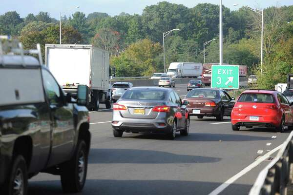 Traffic backs up from the I-95 exit ramp southbound at Exit 3 in Greenwich, Conn. during the morning rush hour on Wednesday, Oct. 10, 2018.