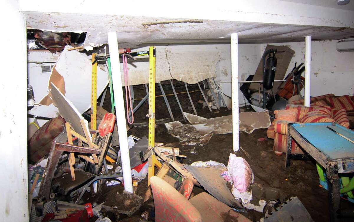 A view of flood damage in the basement of the home of Nelson and Agnieszka Magtangob in Bridgeport, Conn., on Thursday Oct. 11, 2018. Many homes in the neighborhood were damaged by the flooding of the Rooster River after a heavy rainstorm on Tuesday Oct. 2, 2018. Residents are angry that they have not been able to get any aid from FEMA because the mayor did not declare the area a disaster area.