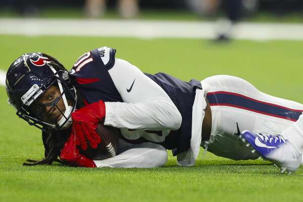 Houston Texans wide receiver DeAndre Hopkins (10) hangs onto a pass but was called down before crossing into the end zone during the second quarter of an NFL football game at NRG Stadium on Sunday, Oct. 7, 2018, in Houston.