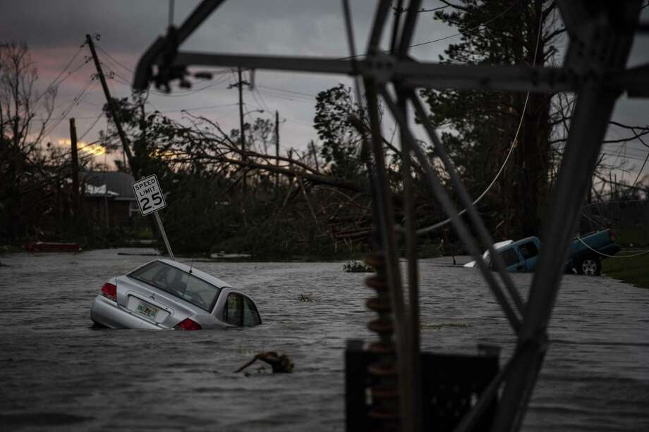 A car is seen caught in flood water in Panama City, Fla., after Hurricane Michael made landfall along the Florida panhandle on Oct. 10, 2018. Photo: Jabin Botsford, The Washington Post / The Washington Post / The Washington Post