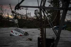 A car is seen caught in flood water in Panama City, Fla., after Hurricane Michael made landfall along the Florida panhandle on Oct. 10, 2018.
