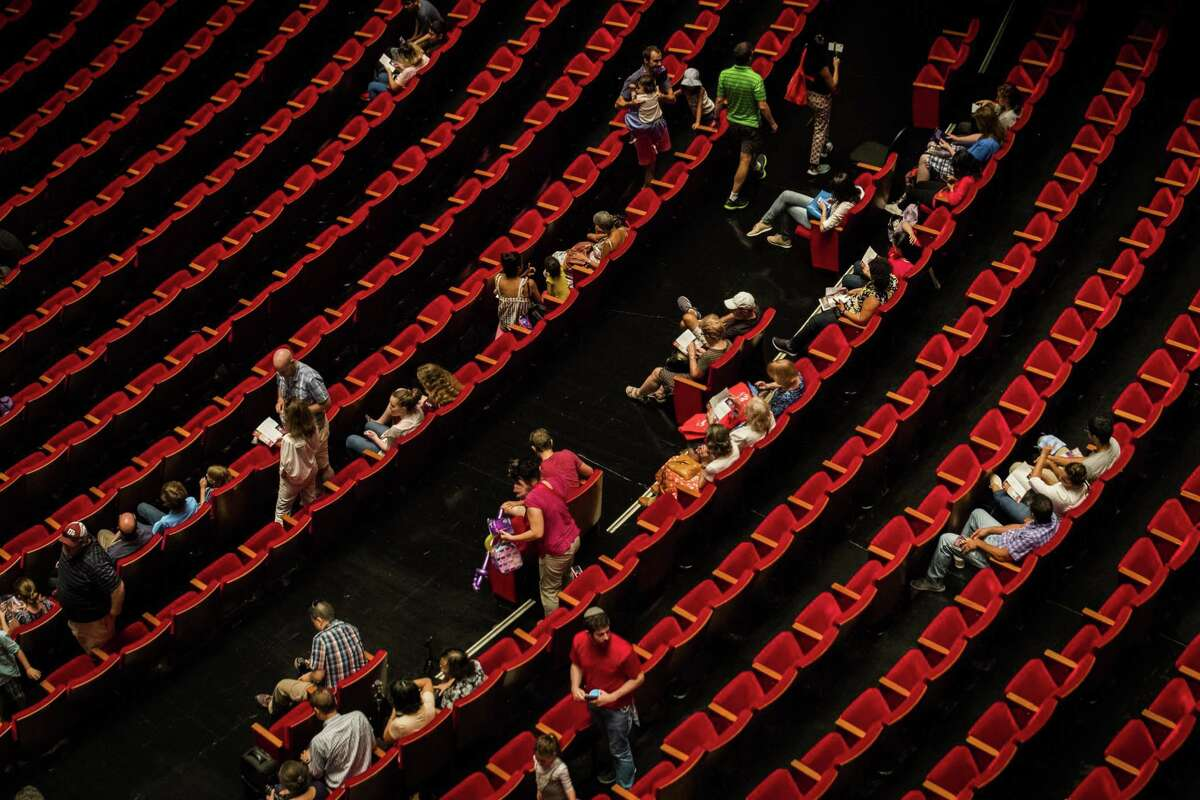 An audience sits waiting for the next performance to start at the Jones Hall during the Theatre District Open House, Sunday, Aug. 26, 2018, in Houston.