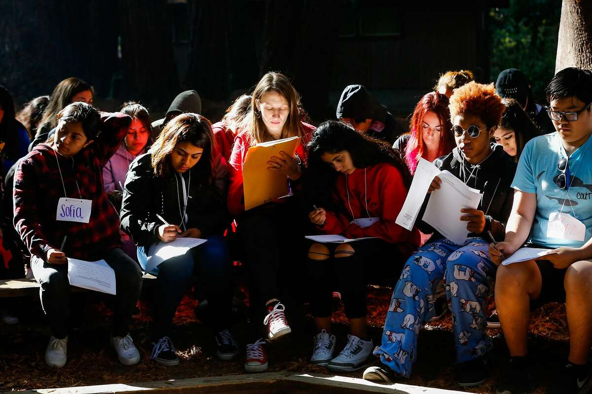 Students write in their journals at Camp Everytown in Boulder Creek, California, on Thursday, Oct. 12, 2017.