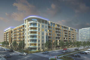 The McAdams, under construction in Memorial City, reflects real estate developer MetroNational's focus on multifamily.