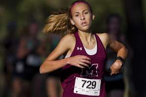 FIL PHOTO — Magnolia's Emma Ellis took second place at the District 19-5A championships on Thursday.