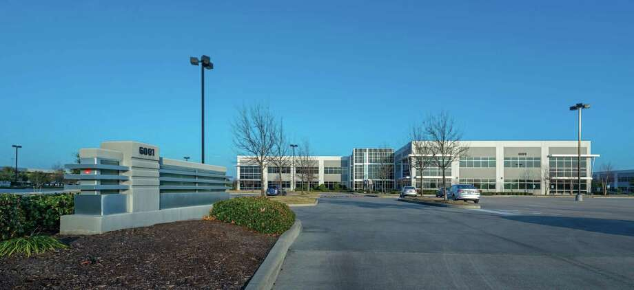 Missouri-based Emerson purchased 6001 Rogerdale, a two-story, 151,000-square-foot office building in Houston's Westchase office submarket. JLL represented the seller, Fort Worth-based 111 Realty OPO. Photo: JLL