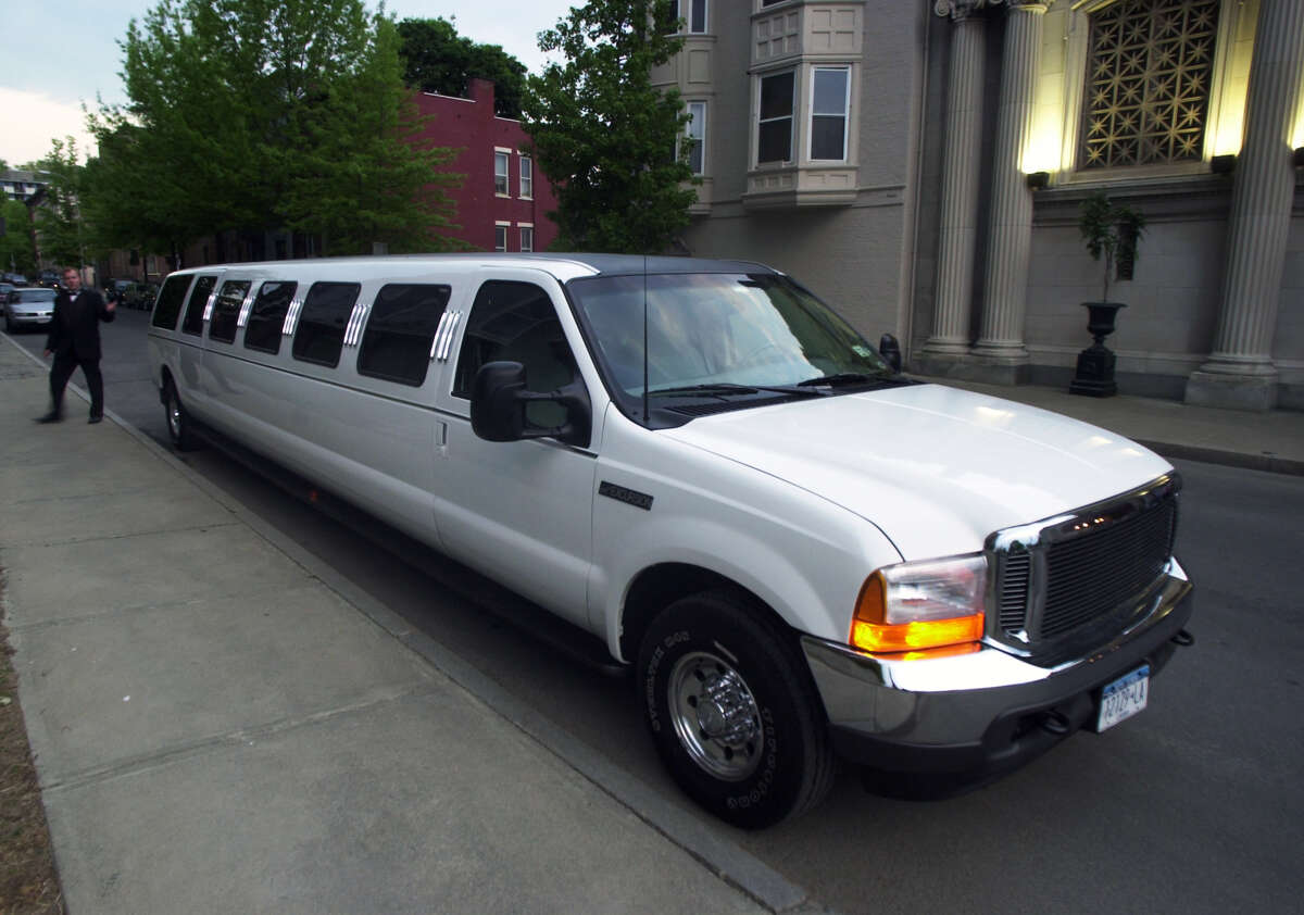 This Times Union photo, taken on May 11, 2001, shows the stretch limo that was later involved in the Oct. 6, 2018 crash in Schoharie County that killed 20 people, including the limo driver and all 17 passengers. At the time this photo was taken, the 34-foot long vehicle was owned by Larry Macera, of Royale Limousine Services of Rensselaer. The vehicle was sold in 2016 to Prestige Limousine of Wilton. This photo was part of coverage of the Maple Hill High School Prom at Franklin Plaza in Troy. (James Goolsby/Times Union)