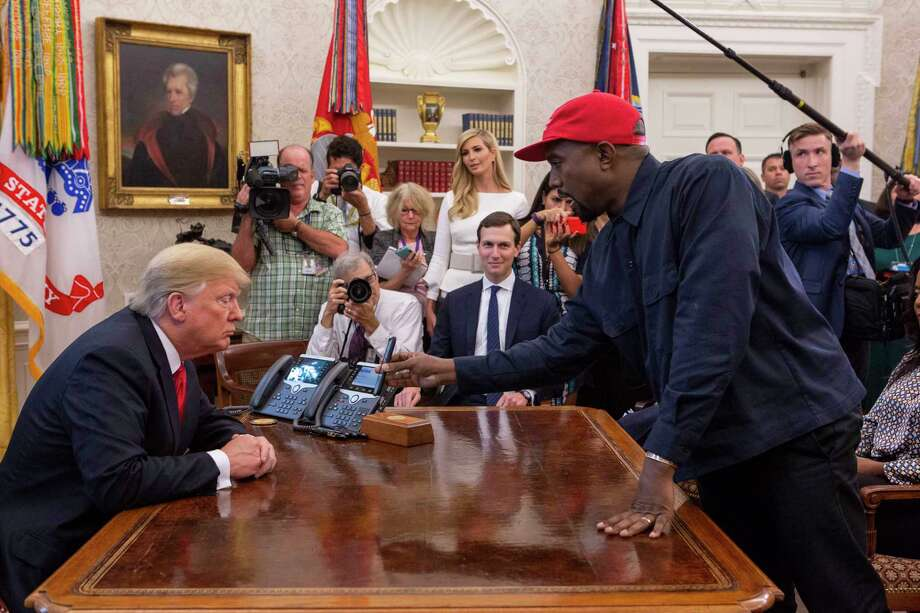 Kanye West shows President Donald Trump a photo of an airplane in the Oval Office in Washington, D.C. on Thursday. Photo: Washington Post Photo By Calla Kessler / The Washington Post